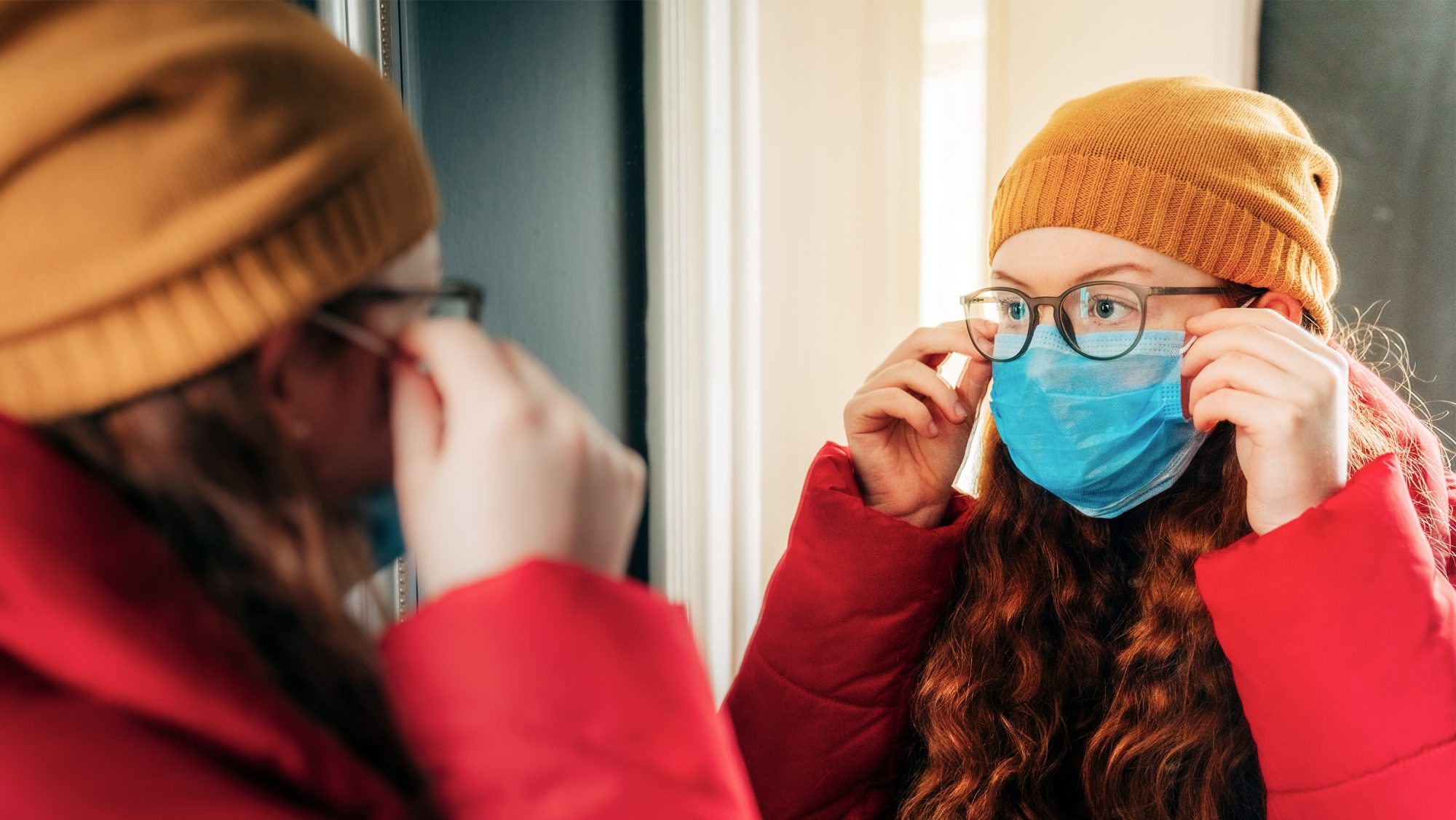 woman wearing glasses and face mask - how to prevent glasses from fogging