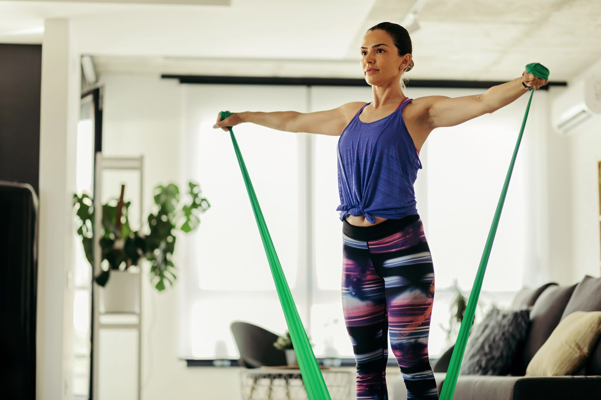 Resistance band workout: woman doing resistance band exercises
