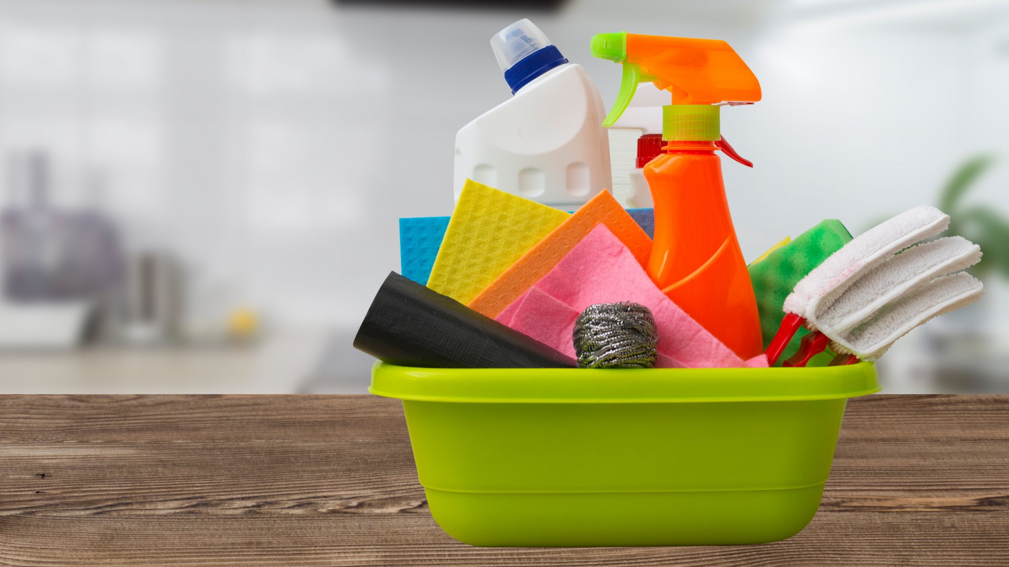 cleaning supplies in colorful caddy