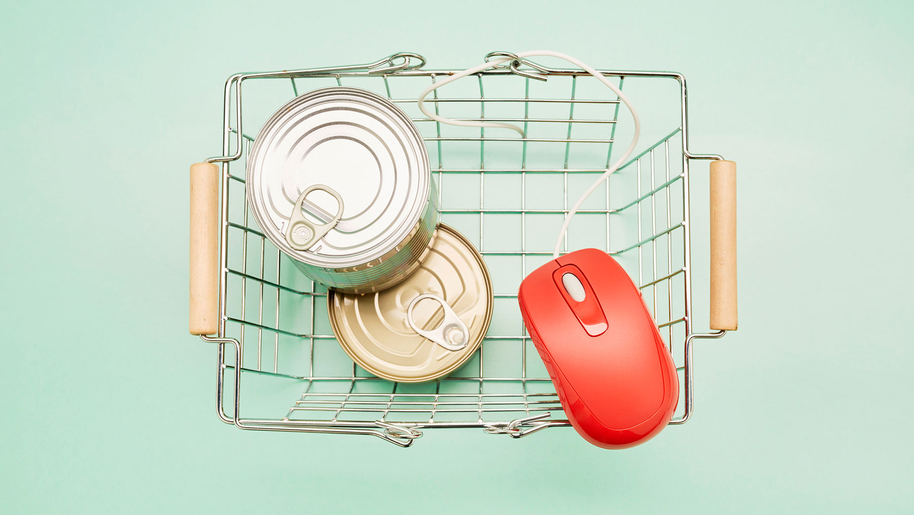 Unexpected Places to Buy Groceries Online, Locally, and For Delivery - grocery basket with cans and computer mouse
