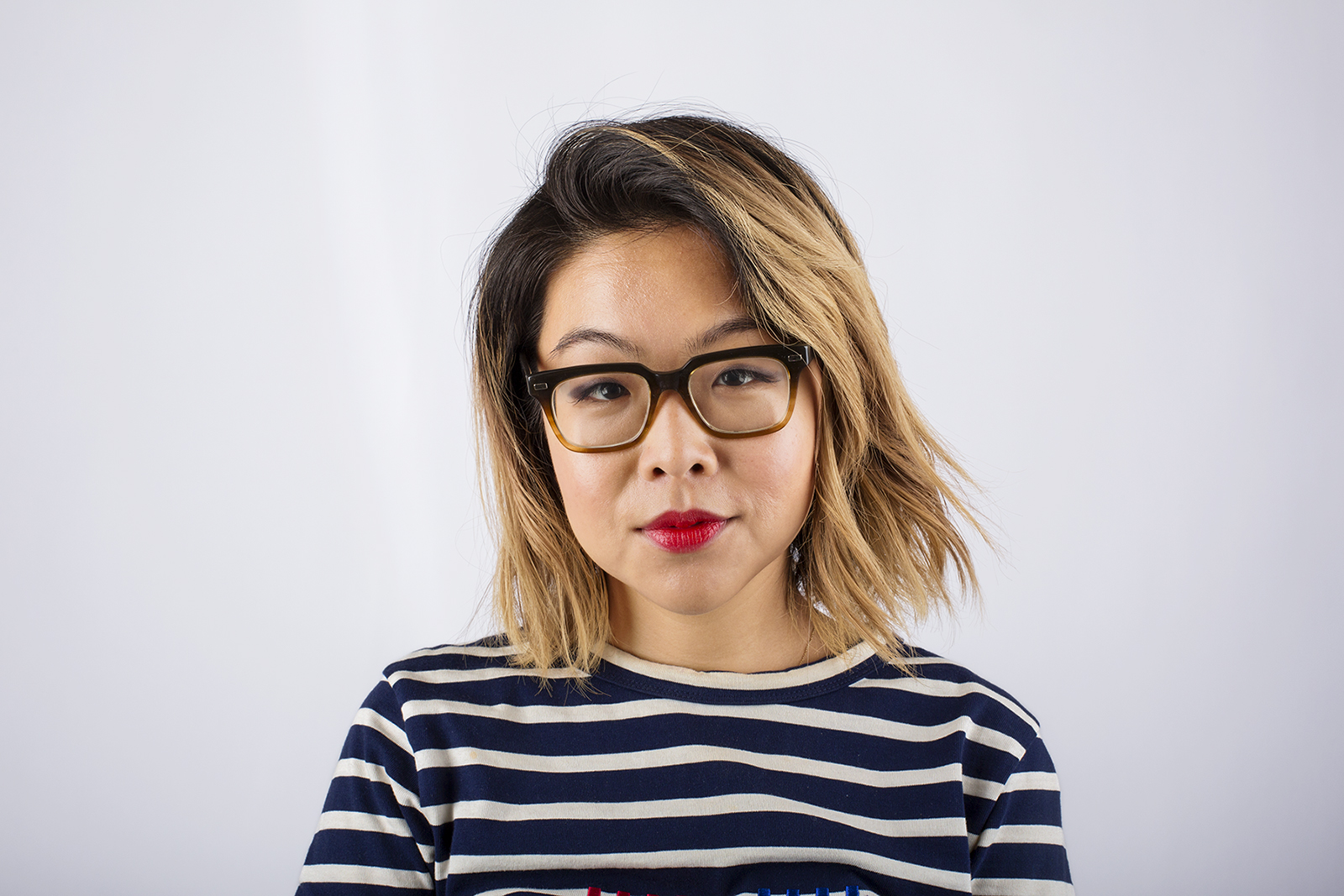 Girl with red lips and glasses