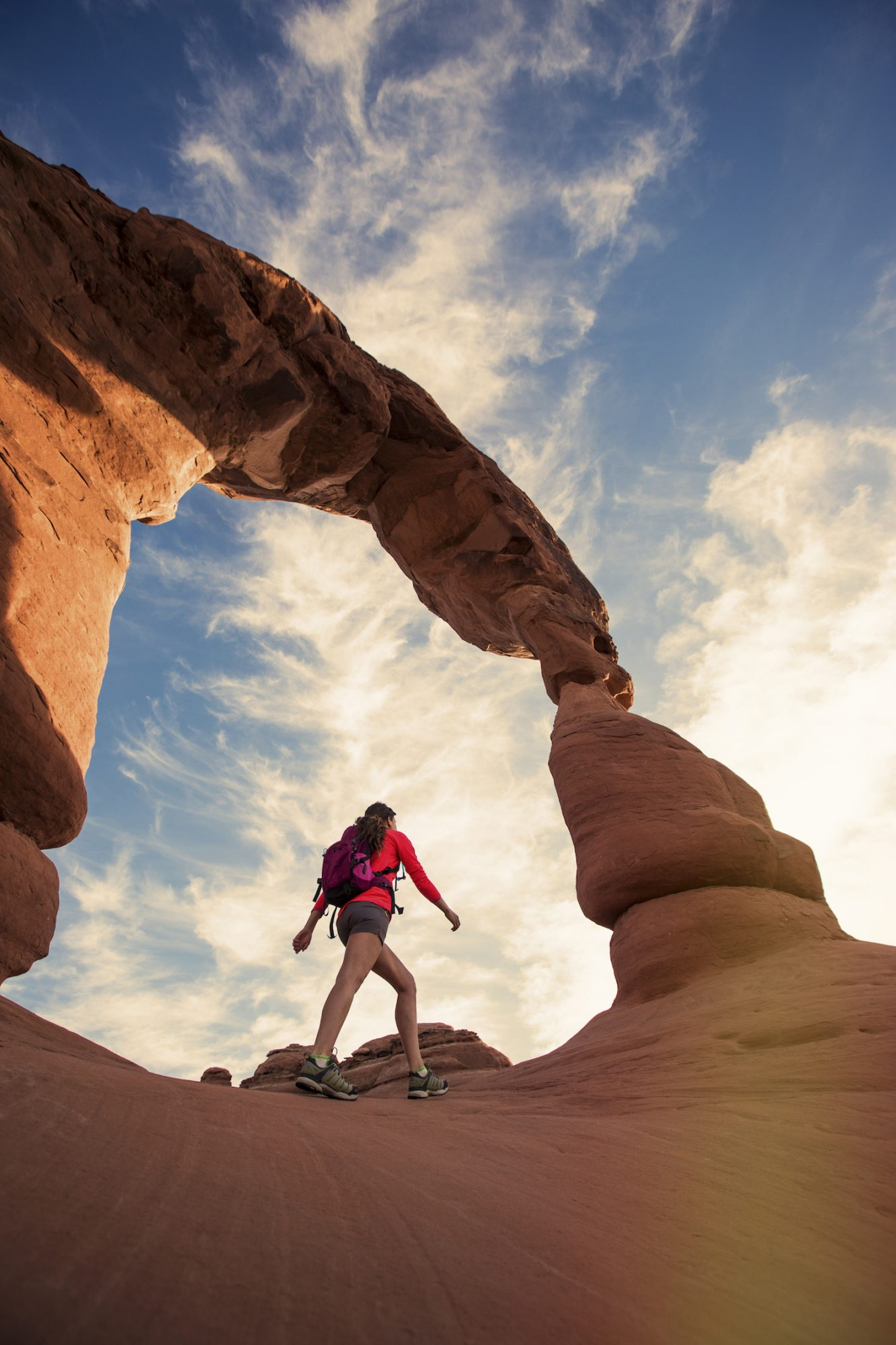 woman hiking in Arches Park