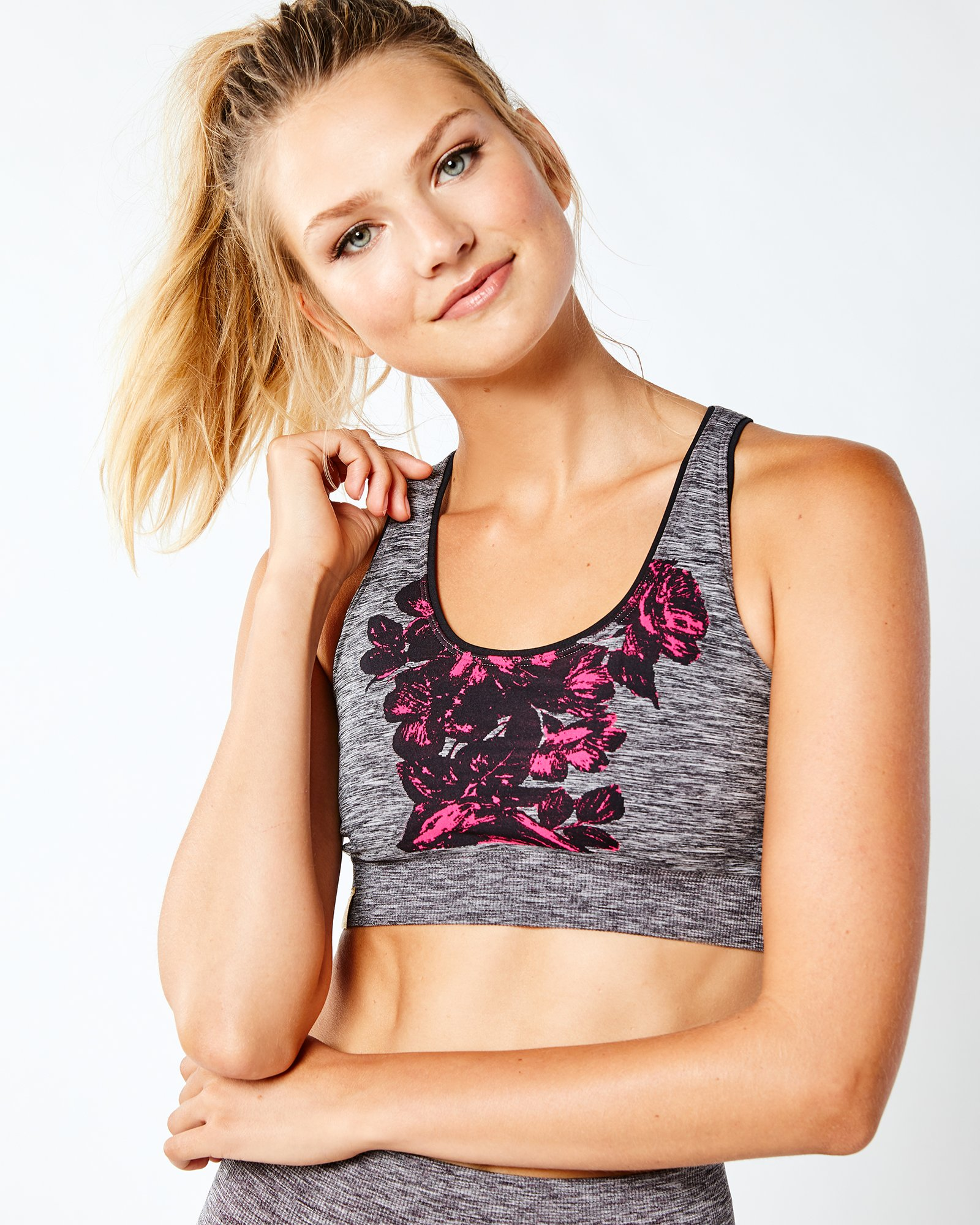 gray and pink printed sports bra