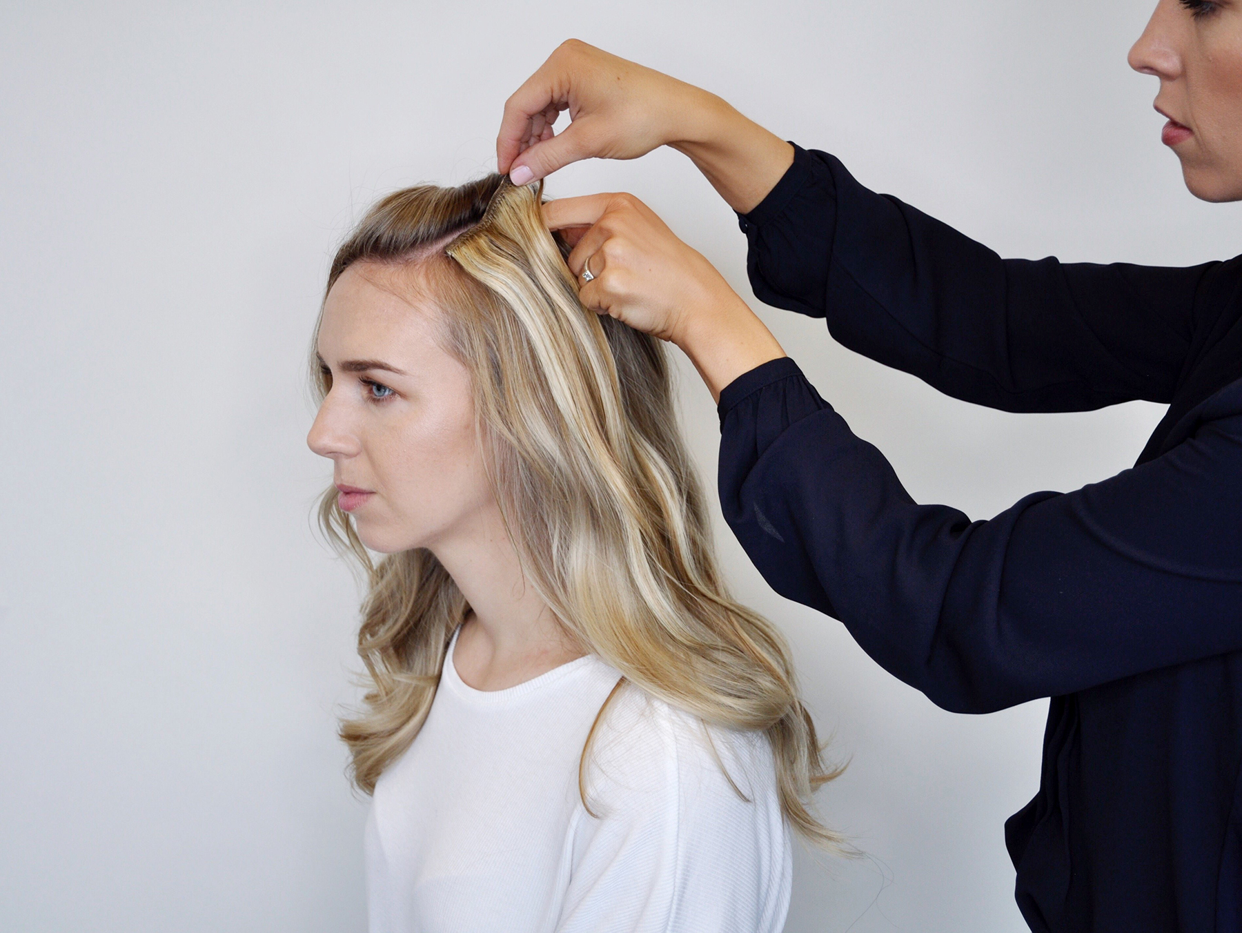 Stylist adding hair sections for waterfall braid