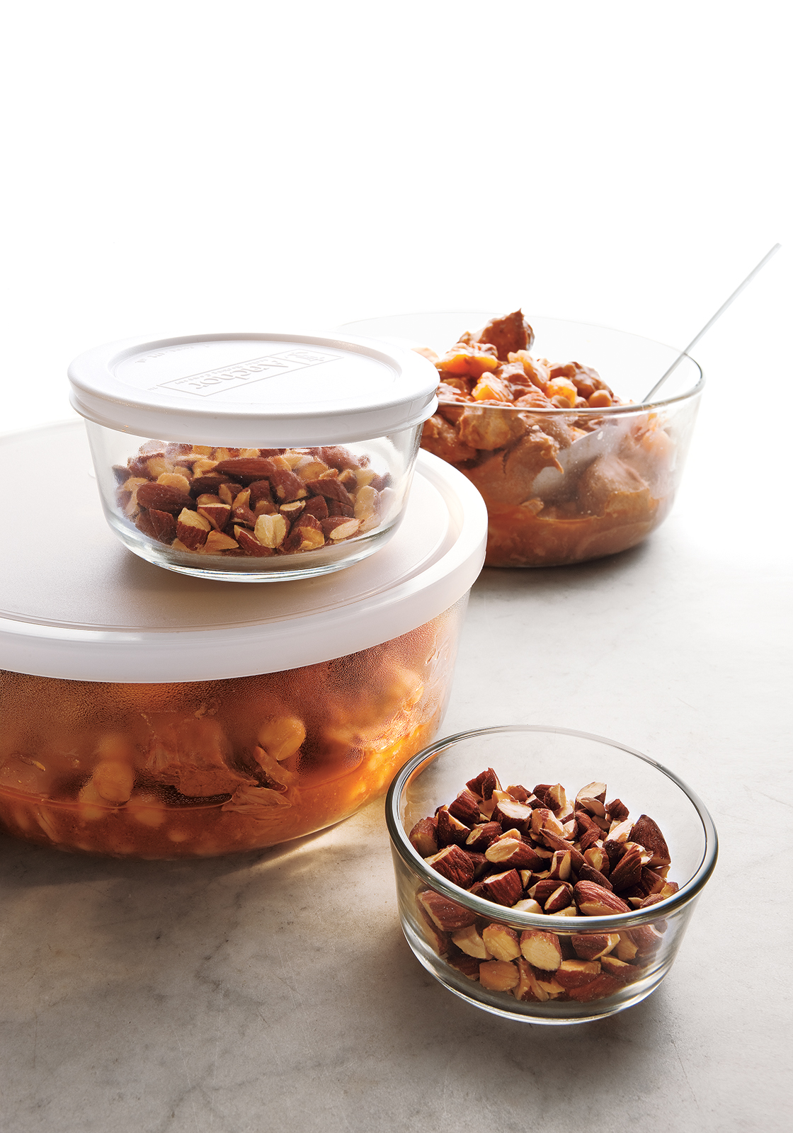 Almonds and Soup in Glass Storage Contatiners