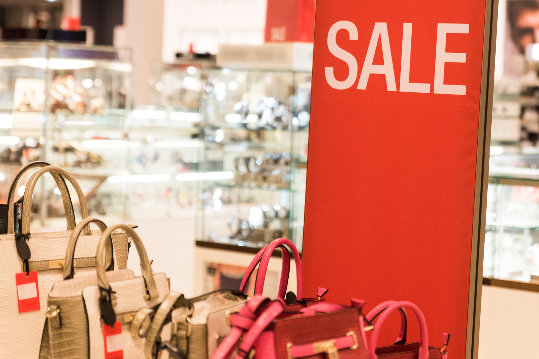 Are outlet malls a good deal? Handbag sale sign