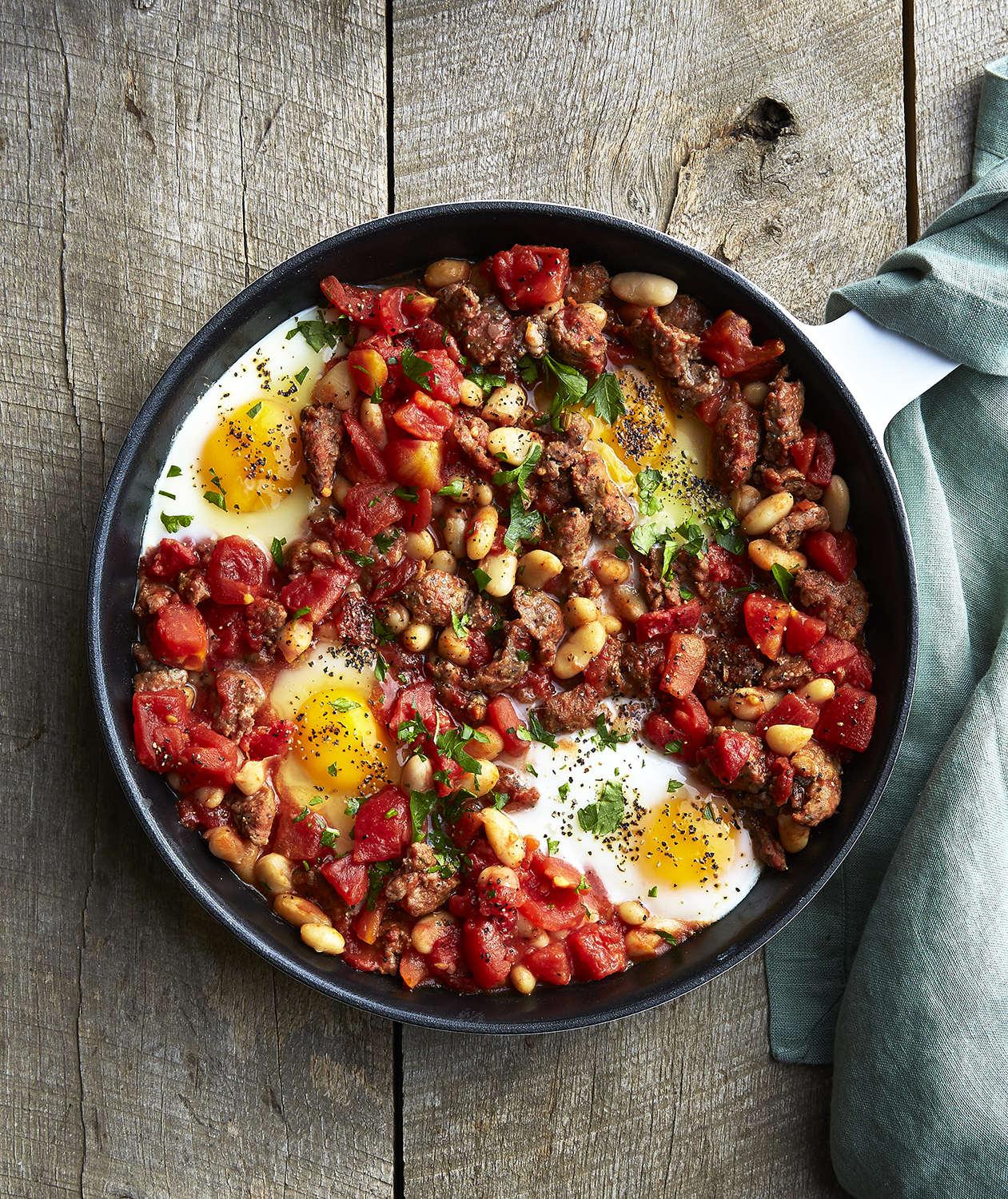 Baked Eggs With Beans and Lamb Sausage