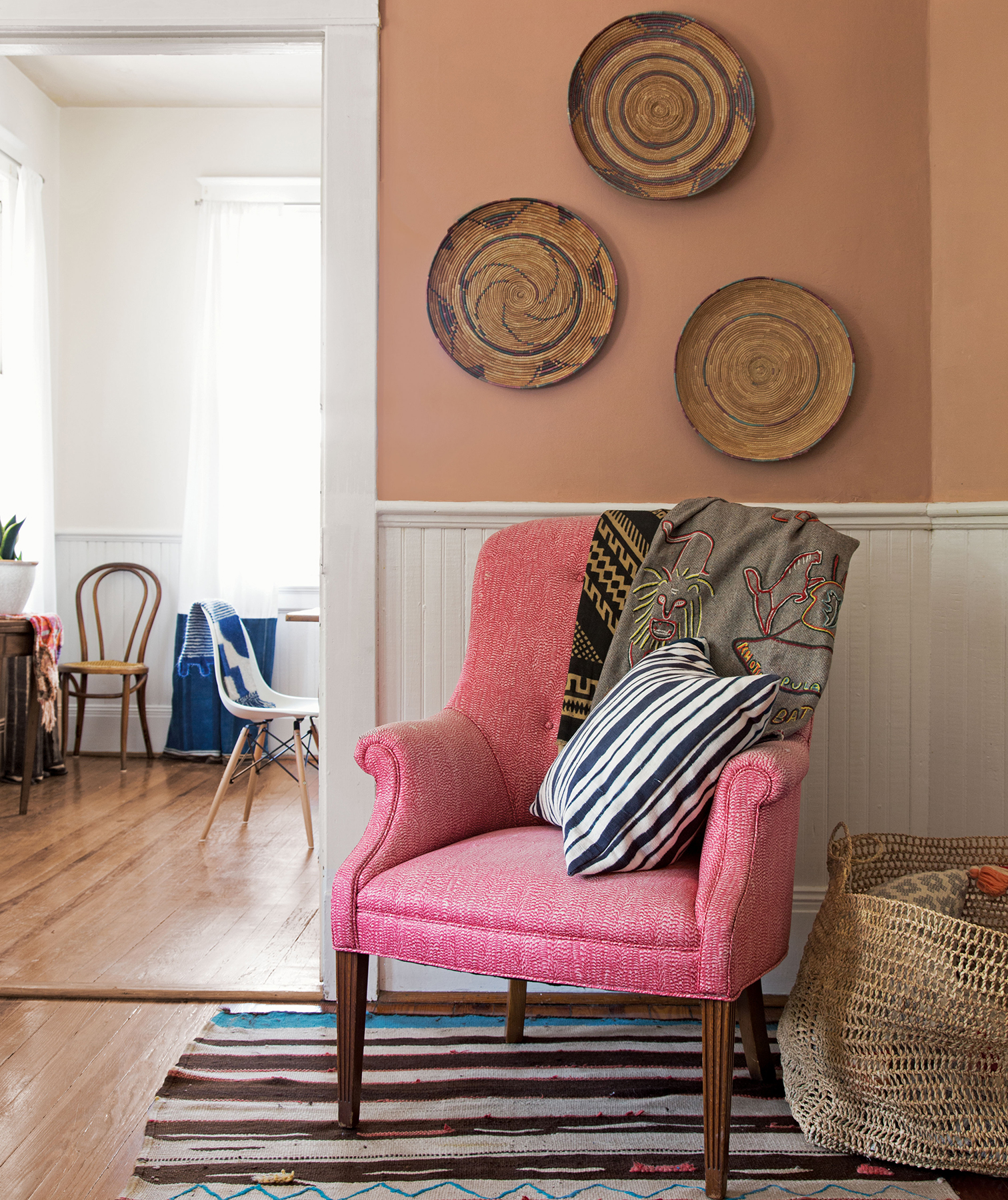 Chair with patterned pillows, throw, rug