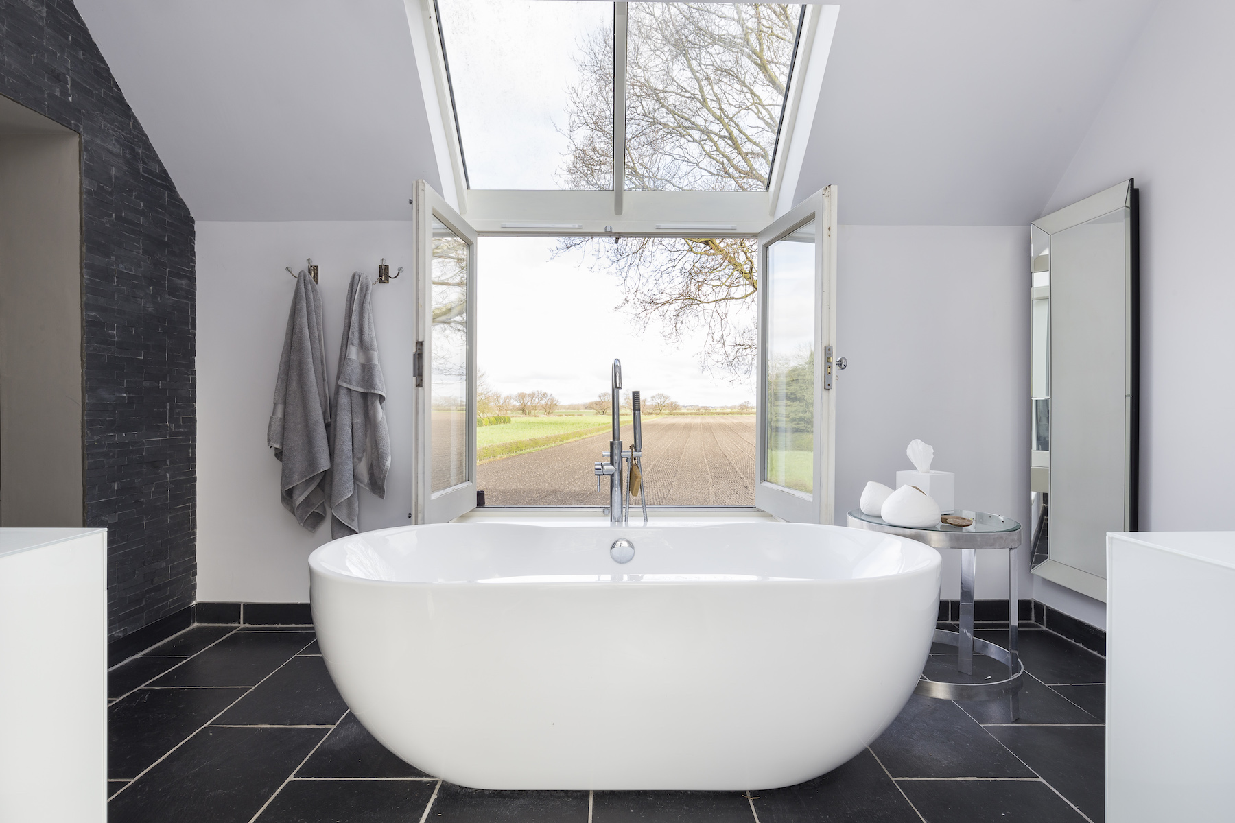 Bathroom Design Trends 2019, Bathtub in beautiful bathroom with view