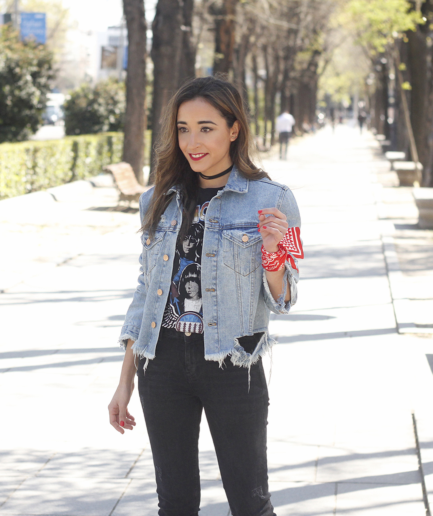 Woman wearing distressed denim jacket with black jeans