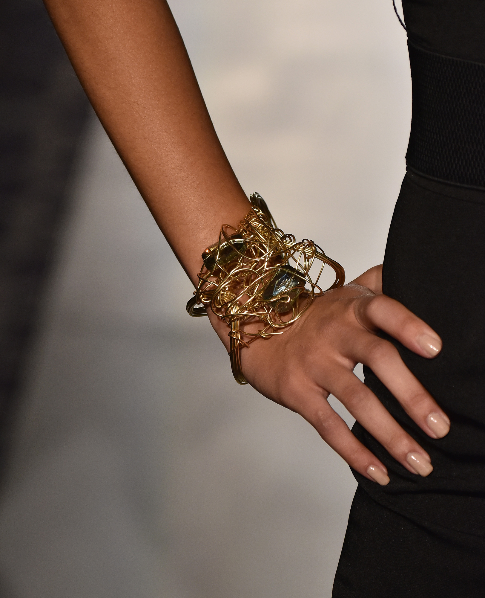 Gold statement bangle with black dress