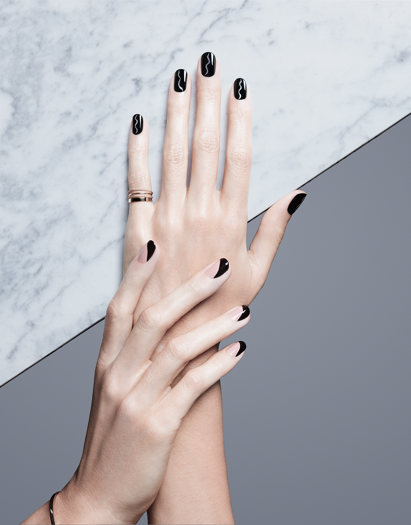 Hands with black and tan manicure