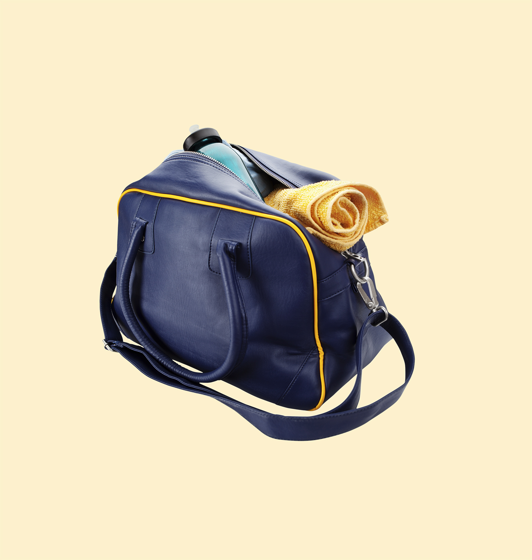 Blue gym bag with yellow towel