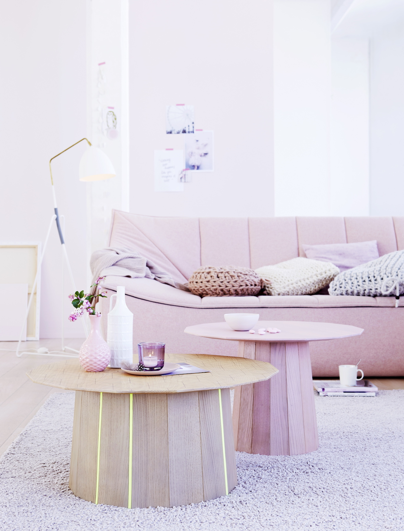 Blush pink living room with sofa and tables