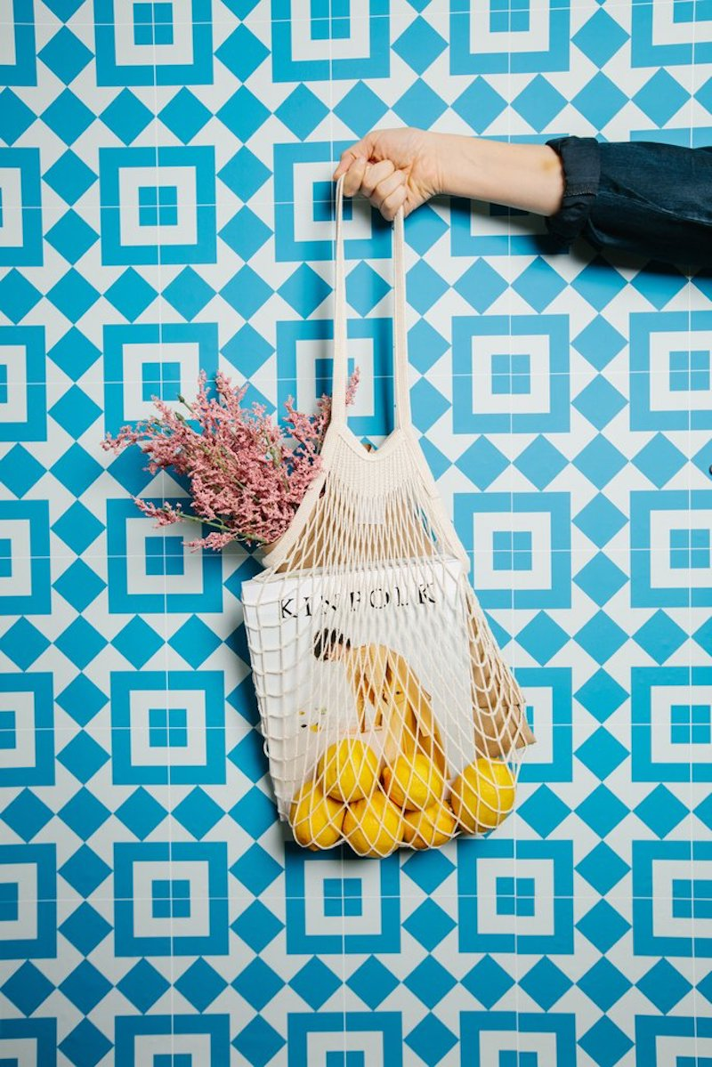 Chasing Paper blue Italian Tile with woven bag and magazine