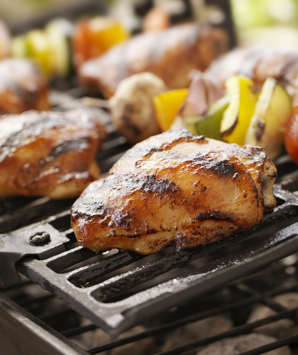 Chicken thighs and kebabs on grill