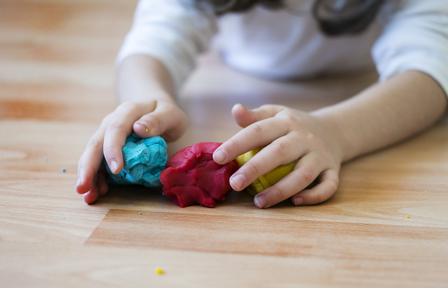 Child playing with Play Doh