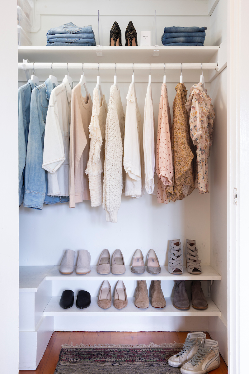 Closet organizing, tidy closet with shoes and blouses