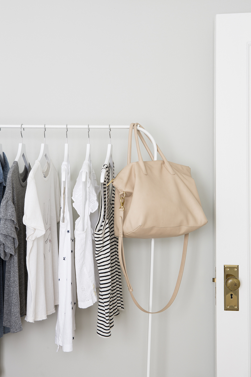 Closet Organizing Mistakes, Clothing rack with blouses and purse