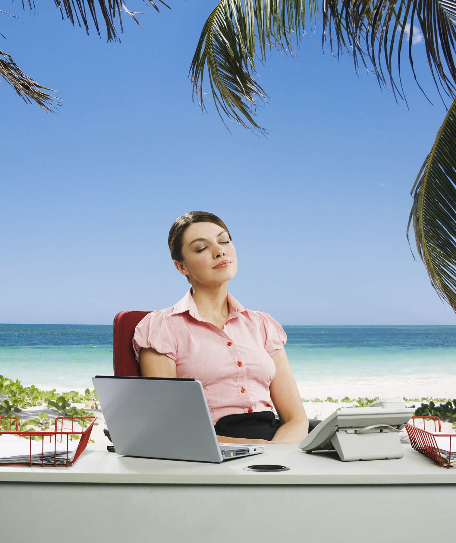 Woman at desk on beach
