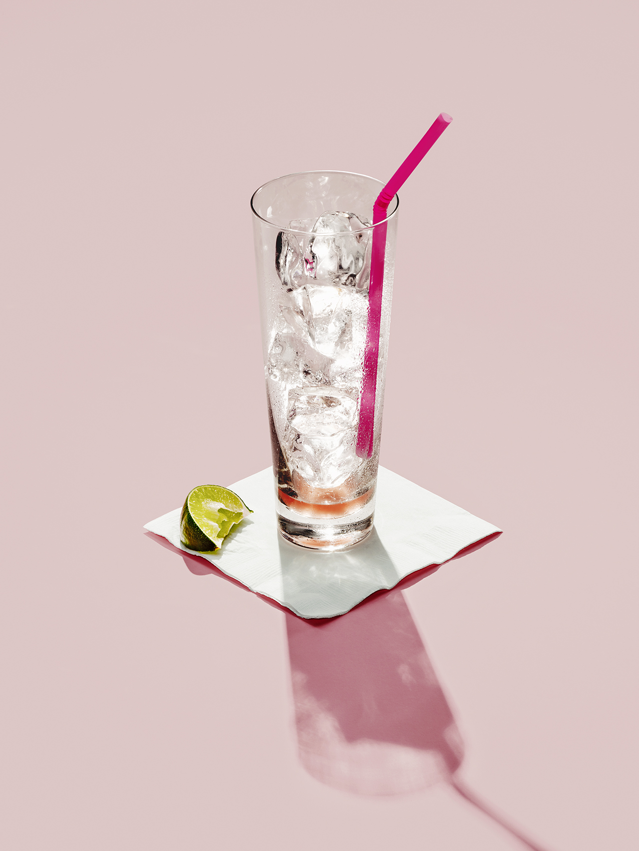 Empty Glass on Pink Background