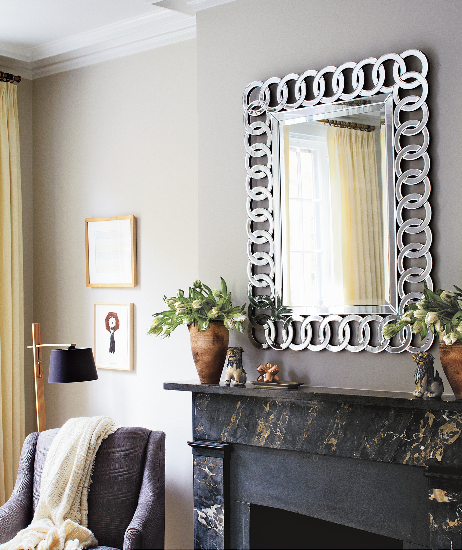 Bold mirror over fireplace