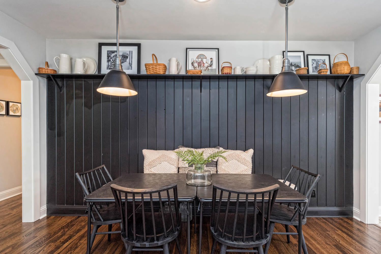 Dramatic Dining Room with black painted shiplap and wood dining table