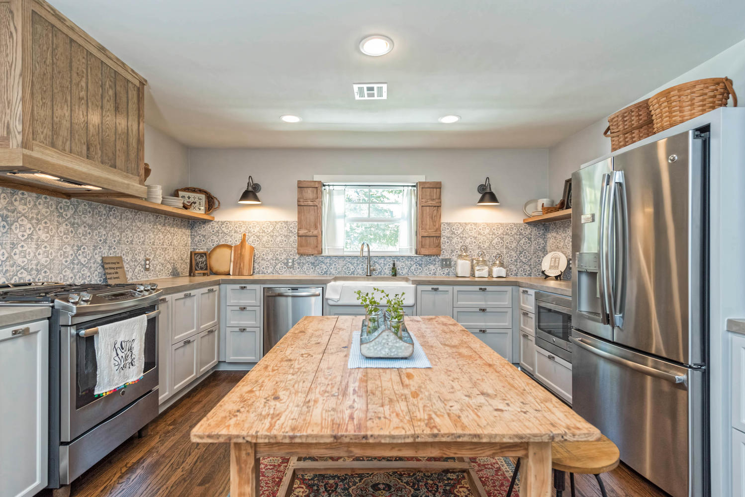 Country Kitchen with wooden island and patterned tiles