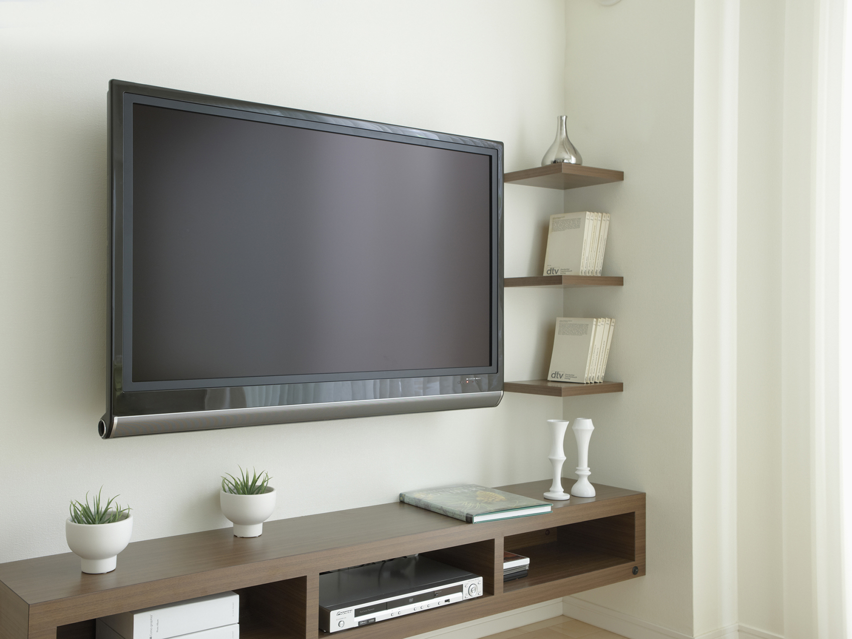Flat-screen television and media console in living room
