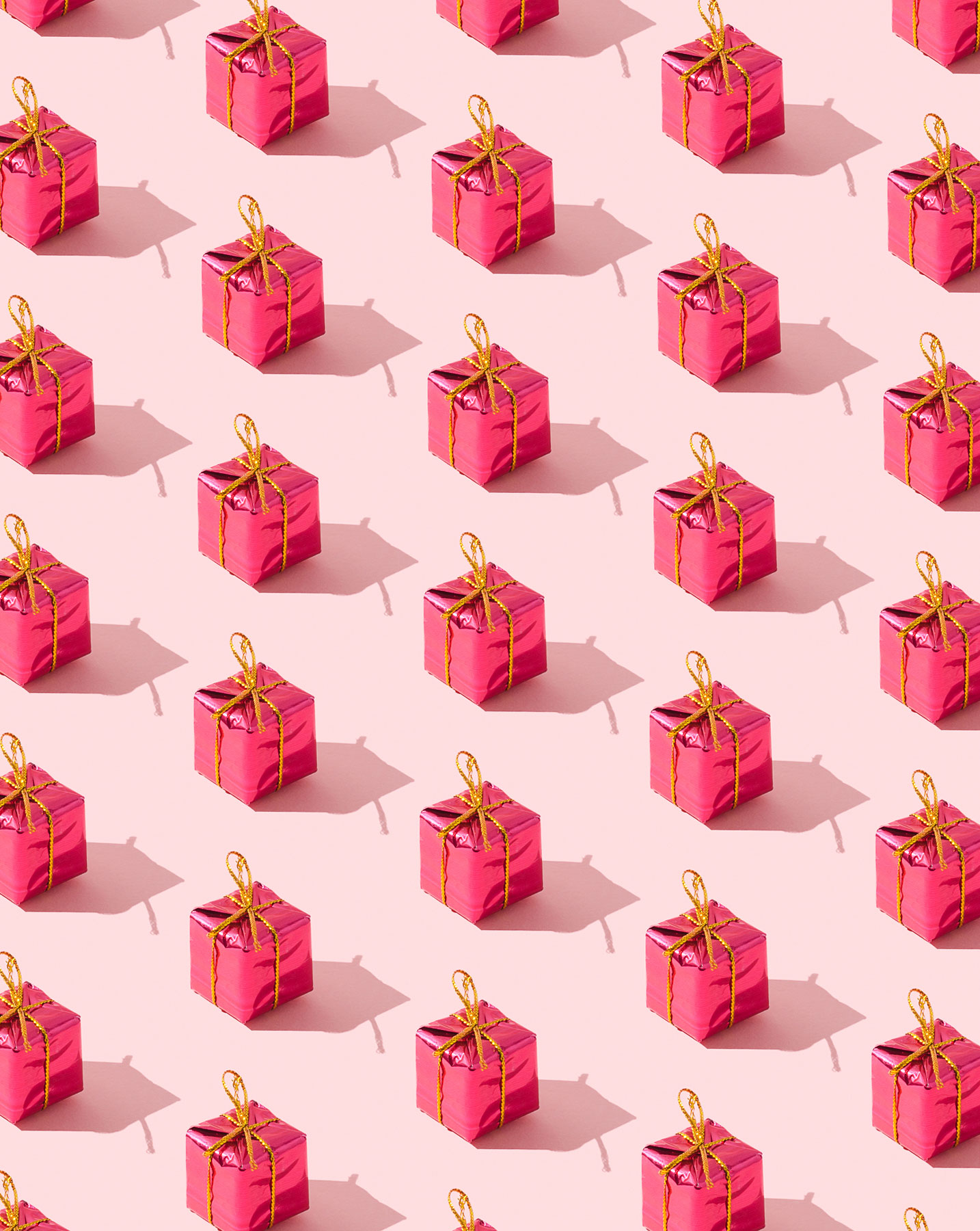 Pink gift wrapped boxes with gold ribbon - gift wrapping secrets