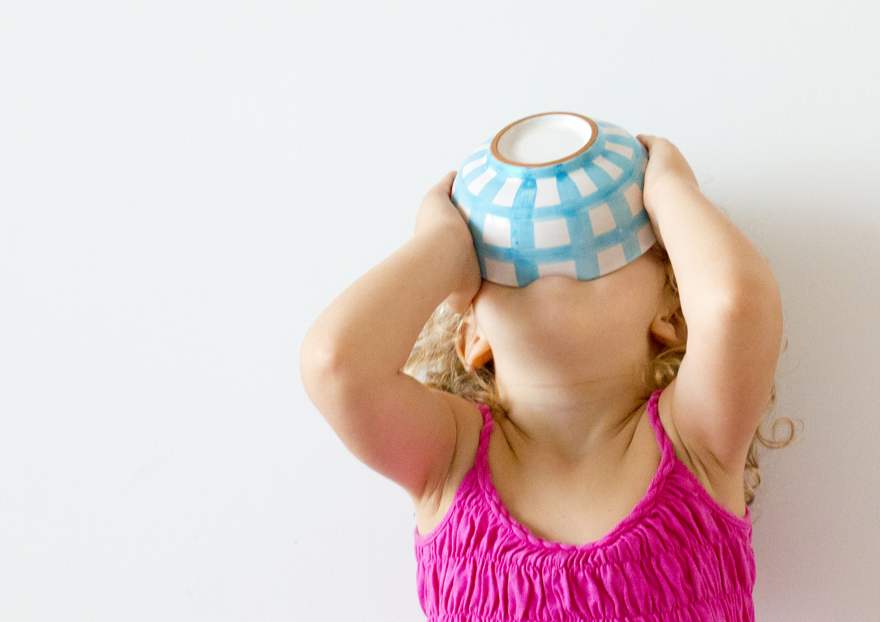 Girl drinking from cereal bowl