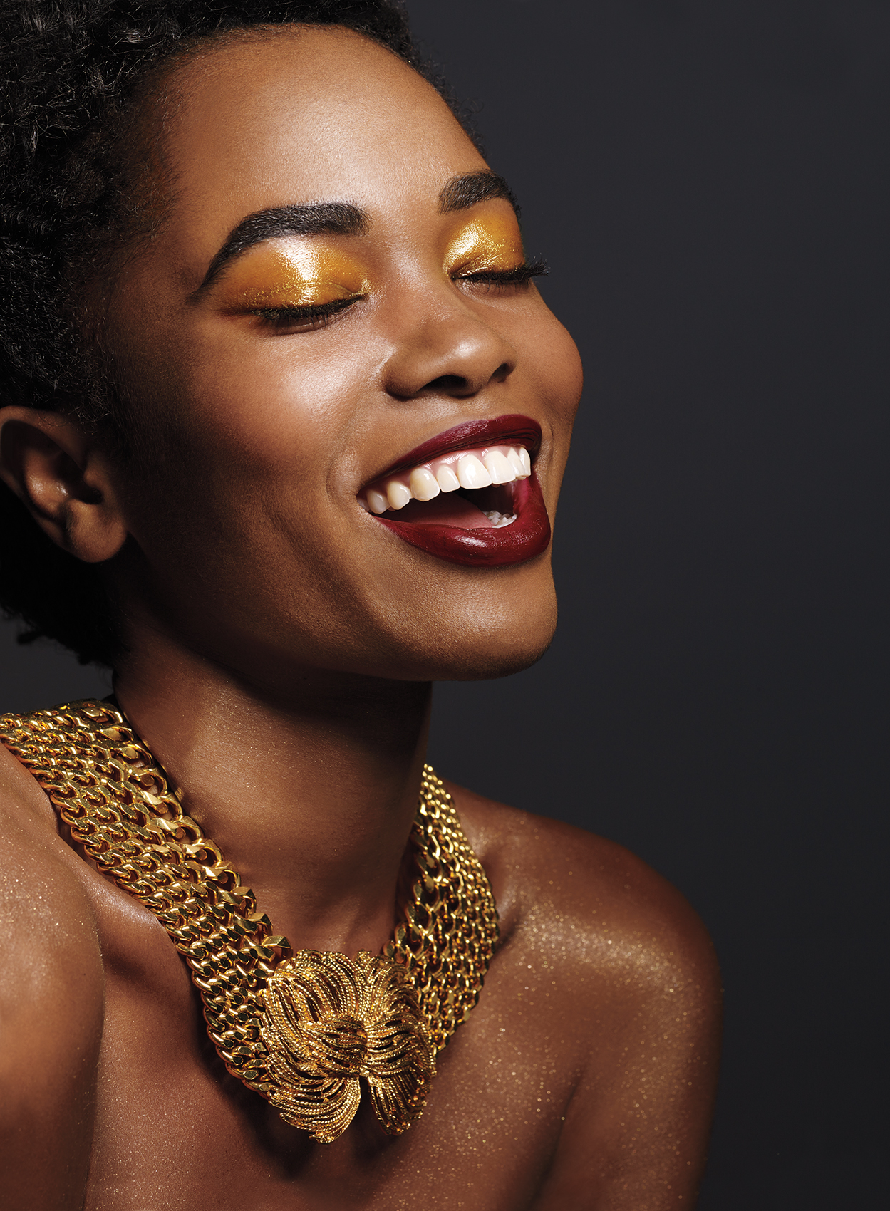 Woman with gold eyeshadow and gold necklace