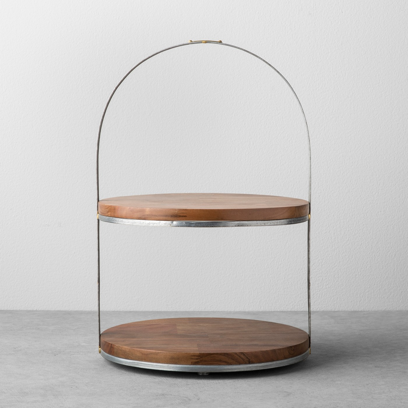Two-tier wooden and metal cake stand