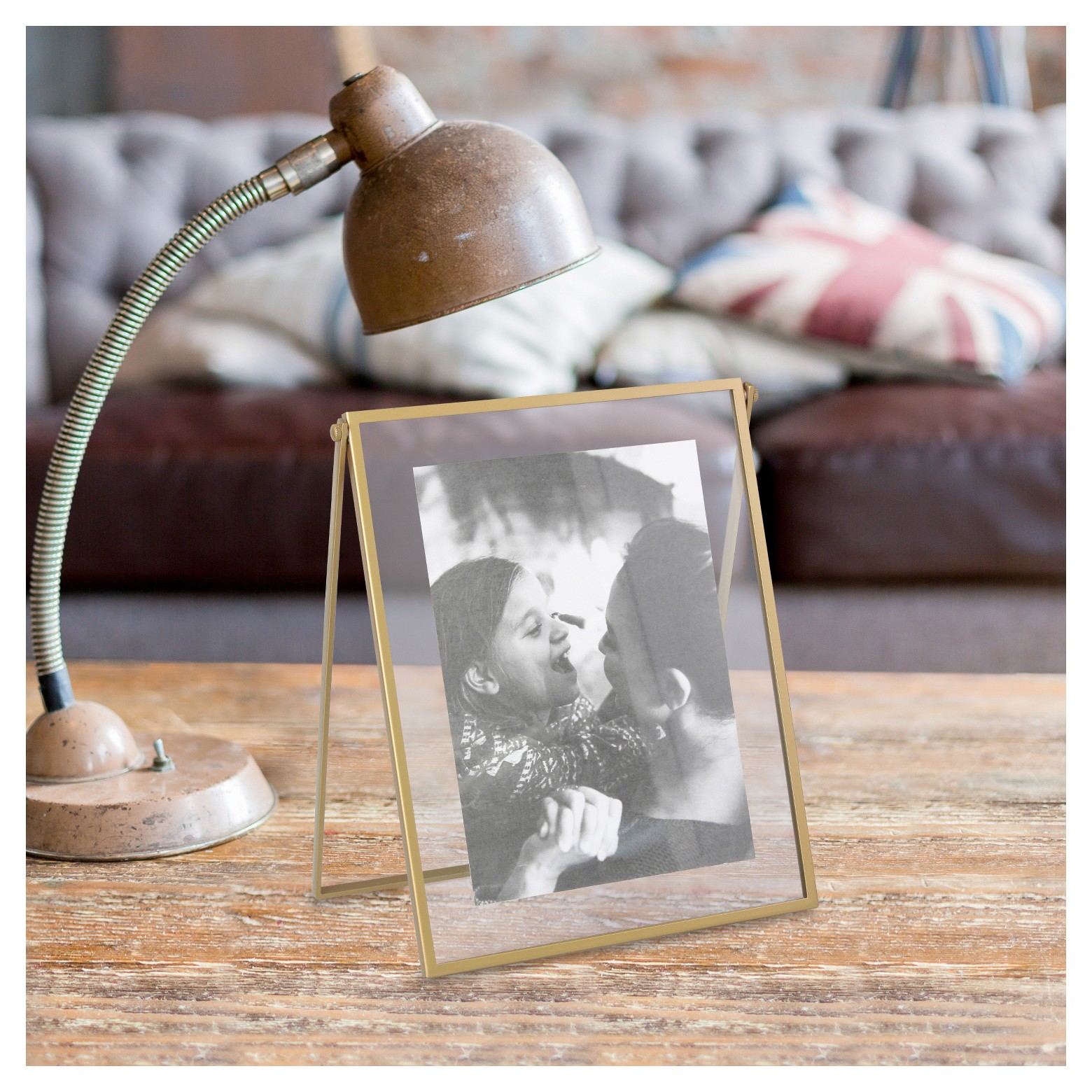 Brass flighting frame on wood surface with lamp