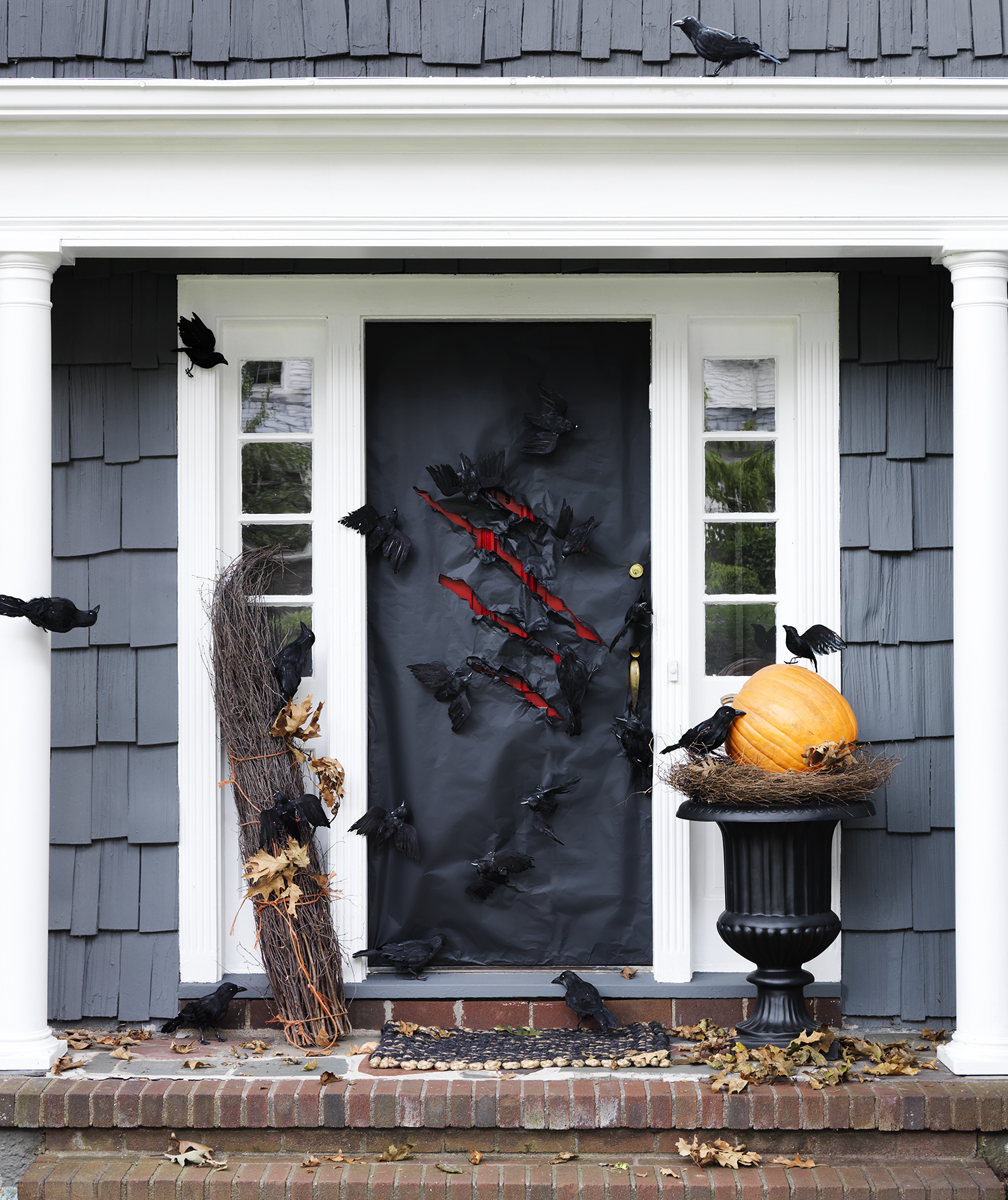 Black wrapped door decorated for Halloween