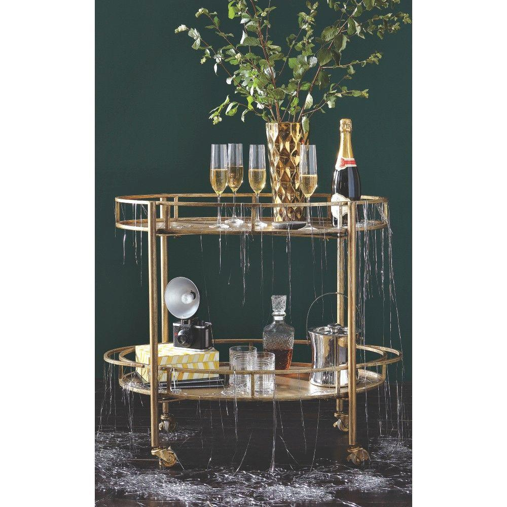 Eliza gold bar cart with glasses and tinsel