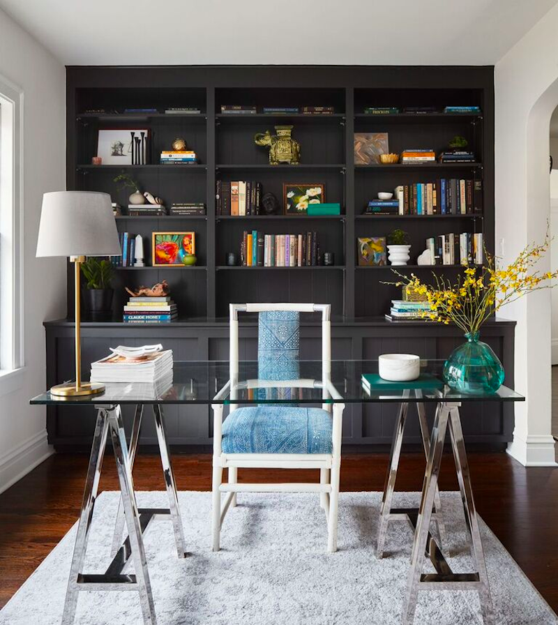 stylish remodeled office with black painted cabinetry