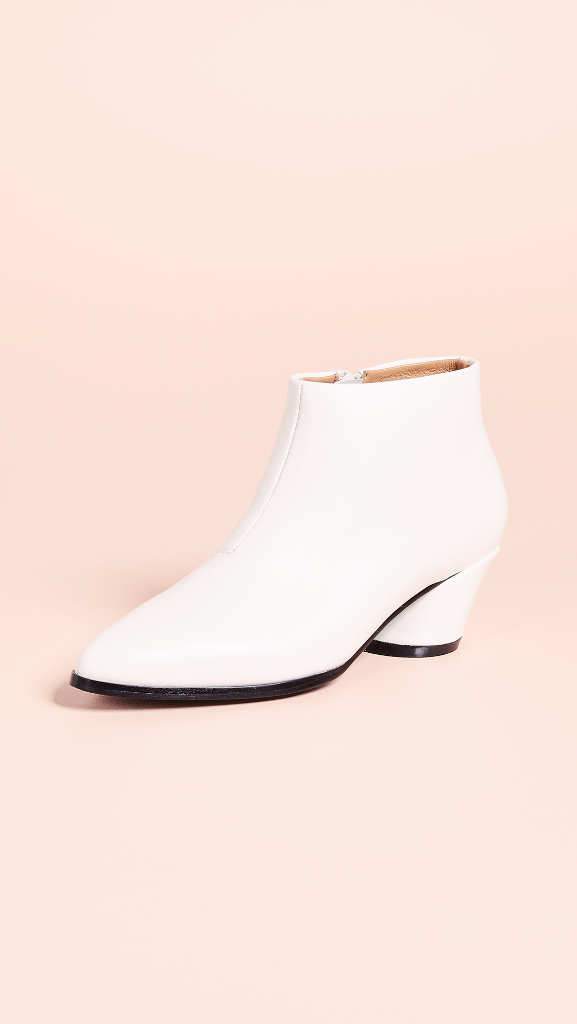 white ankle booties with angular heel