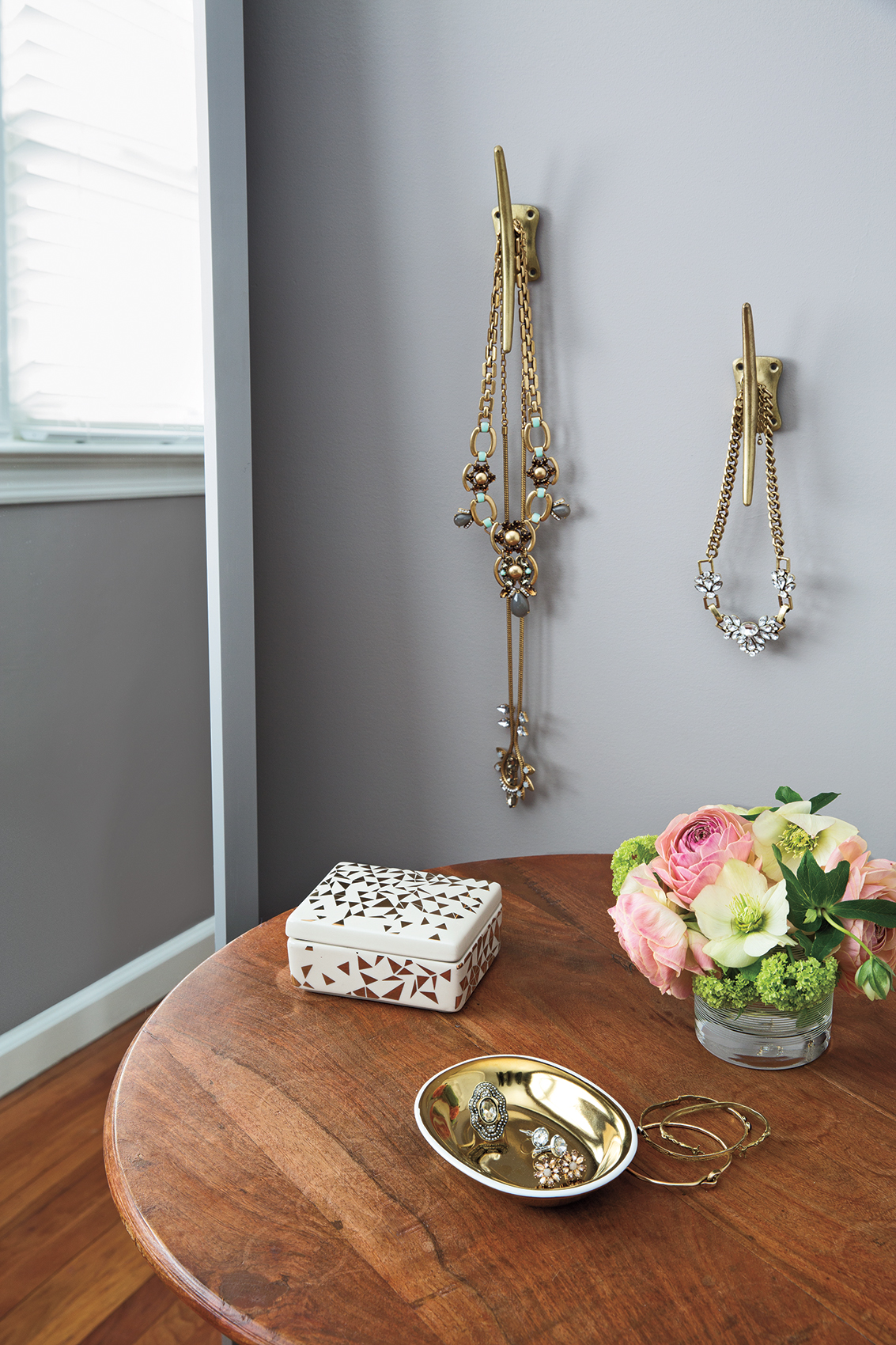 Jewelry hanging neatly on wall