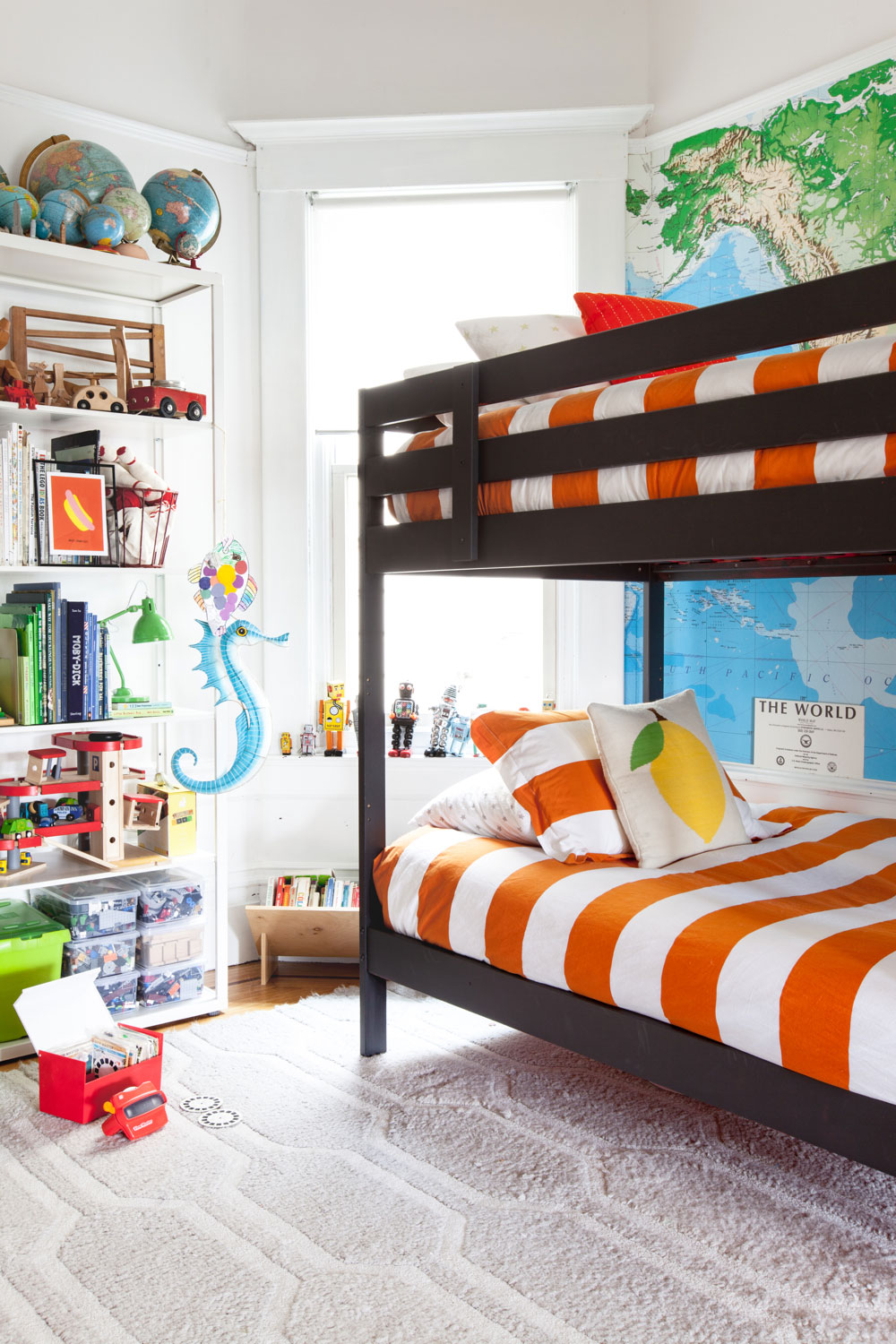 Boys' room with map on wall and bunk beds