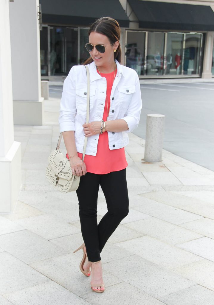 Woman Smiling in White Jean Jacket With Bright Shirt Underneath
