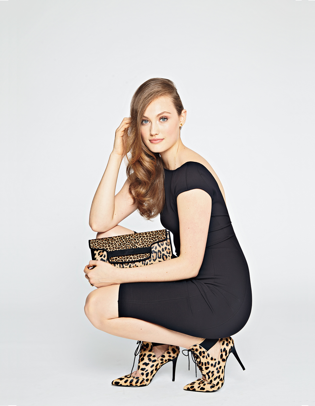 Model wearing black dress and leopard print accessories