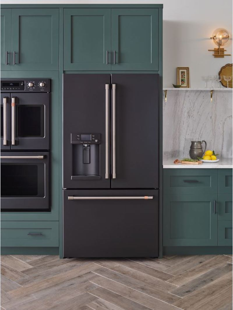 Matte Appliance Trend, Black Refrigerator in kitchen with green cabinets