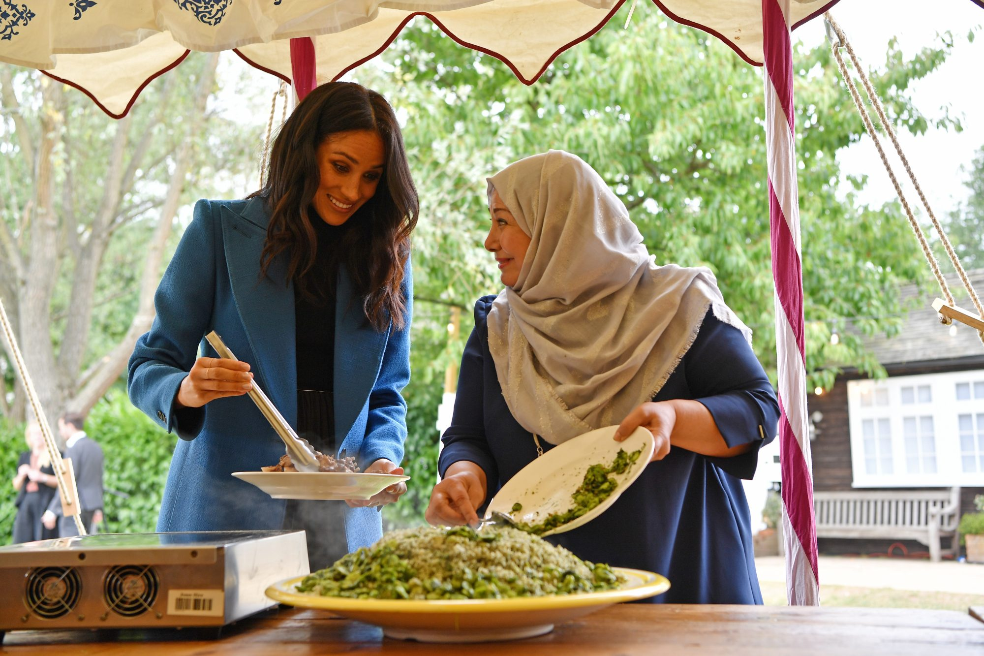 Meghan Markle Serving Food