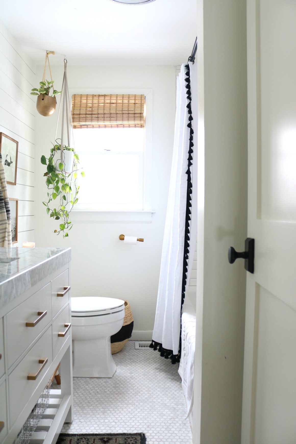 Nesting with Grace Bathroom After with Tile Flooring