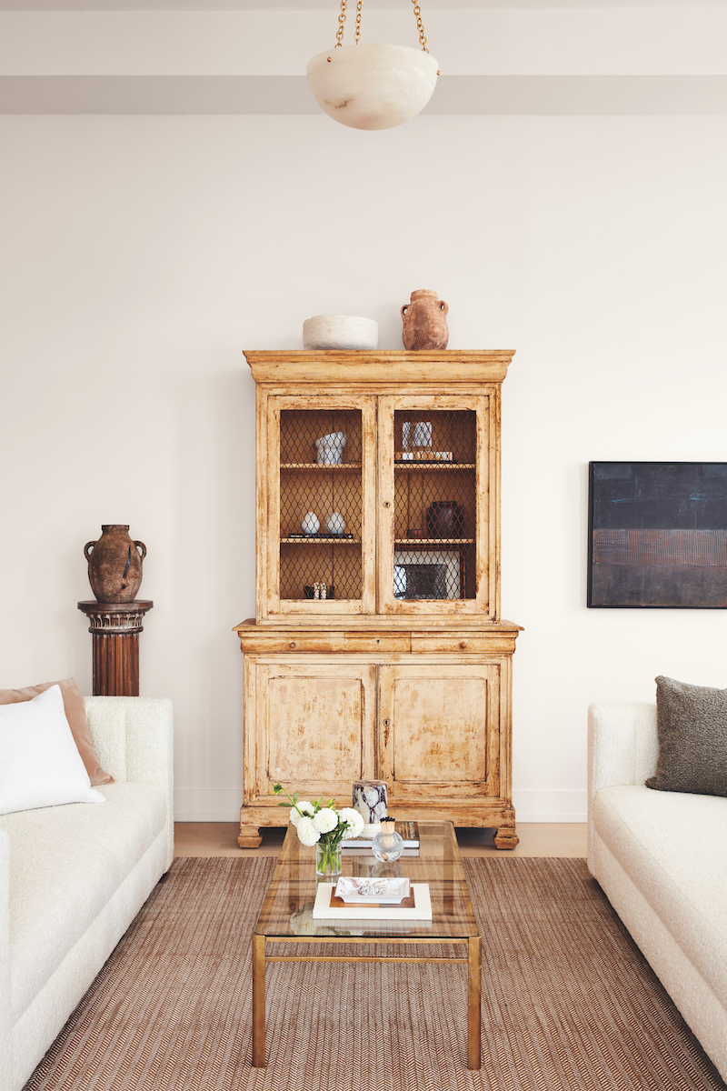 Armoire with storage in living room of the Real Simple Home
