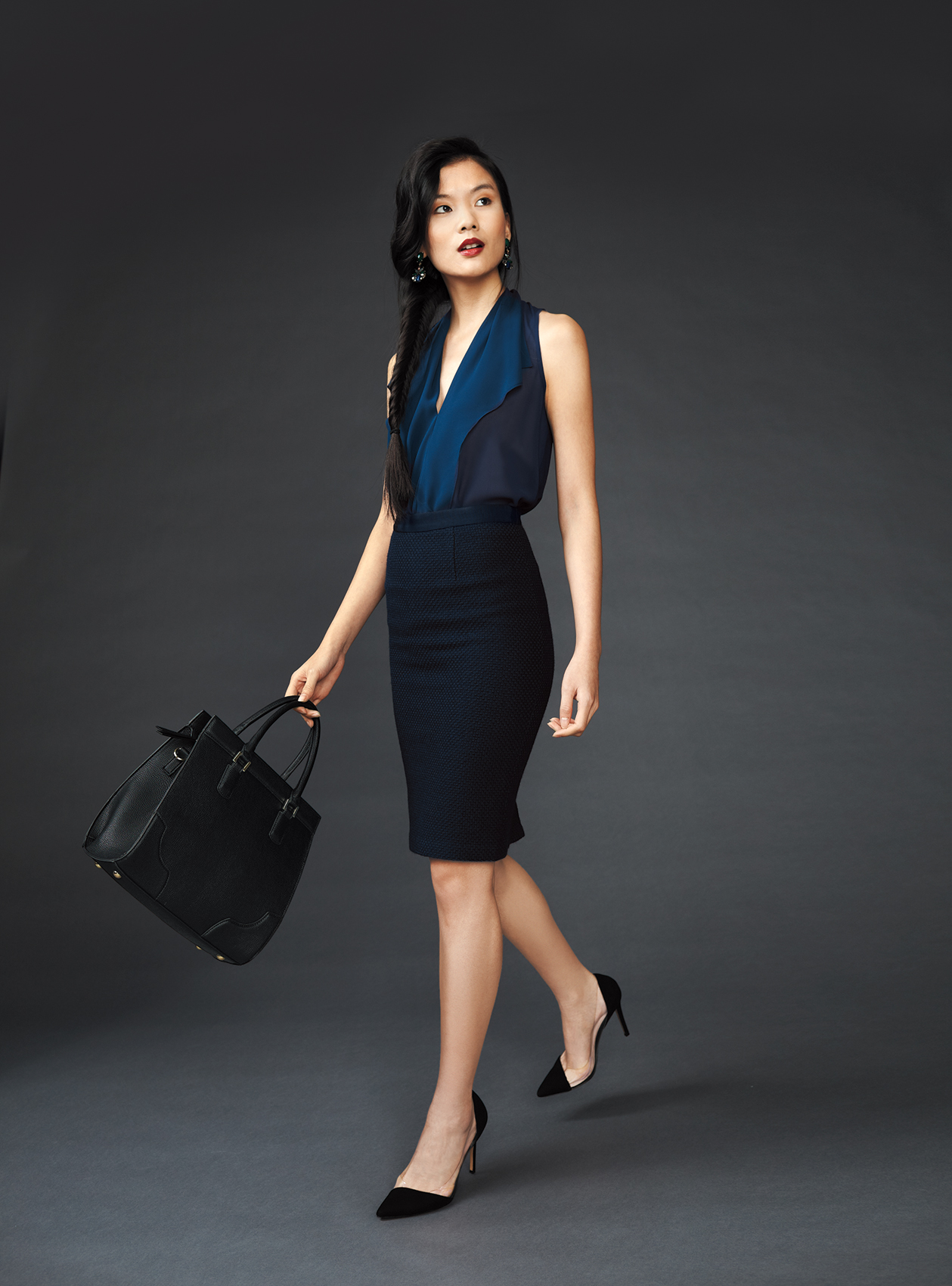 Model wearing blue blouse and navy pencil skirt.
