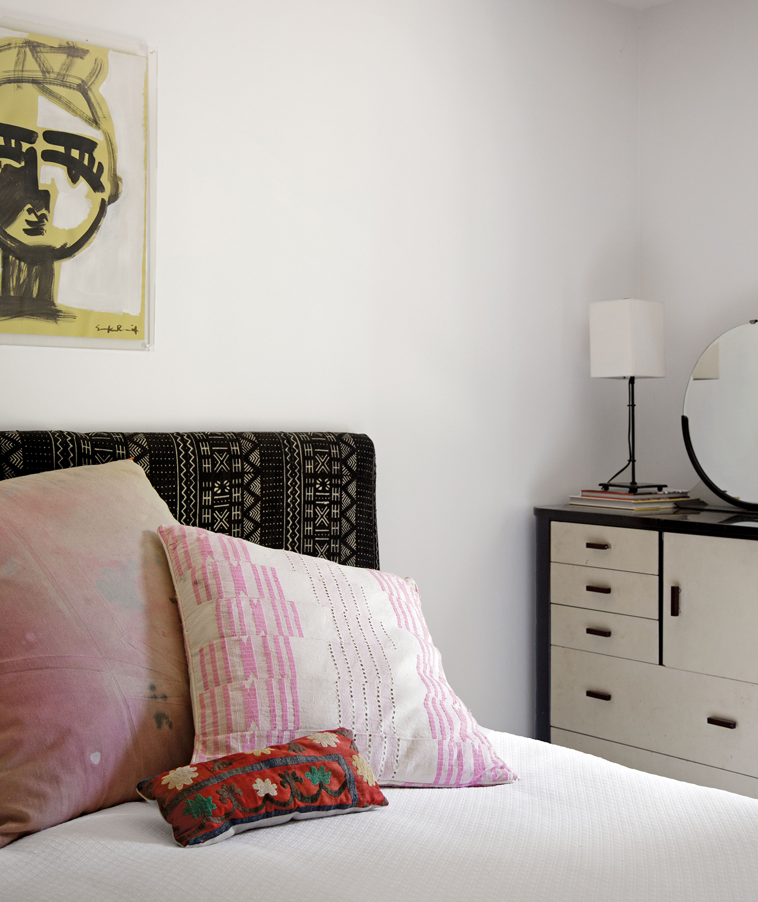 Bedroom with pillows and art with similar motifs