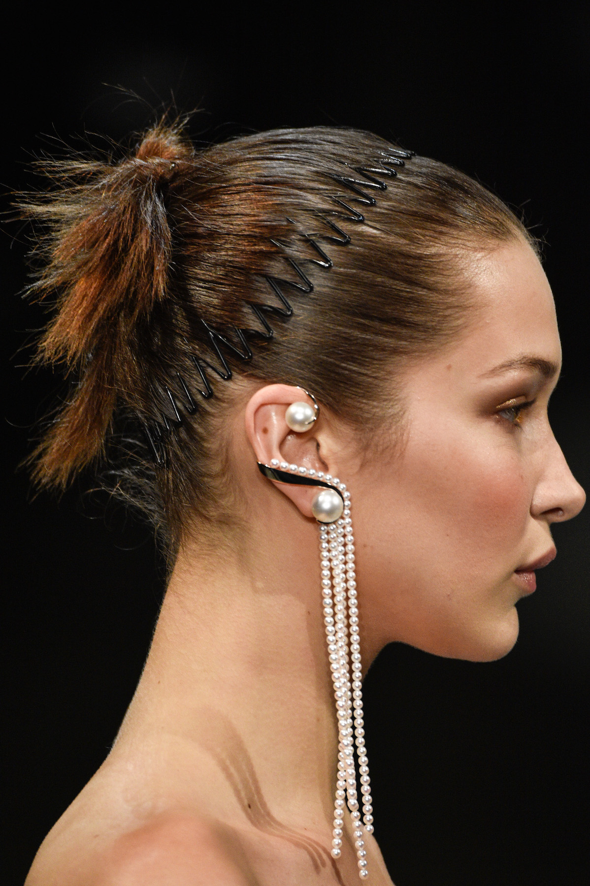 Model at a Prabal Gurung show wearing stretch comb in hair