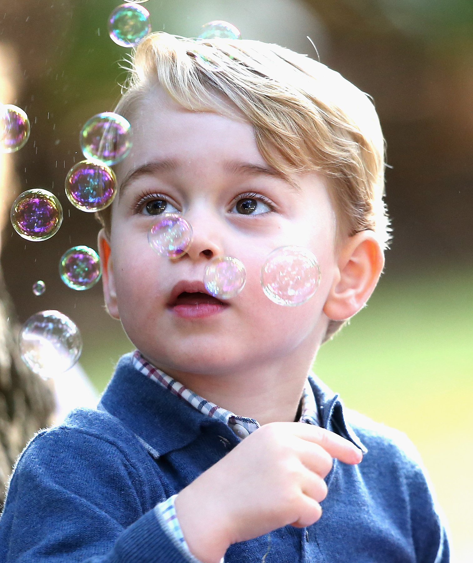 Prince George playing with bubbles
